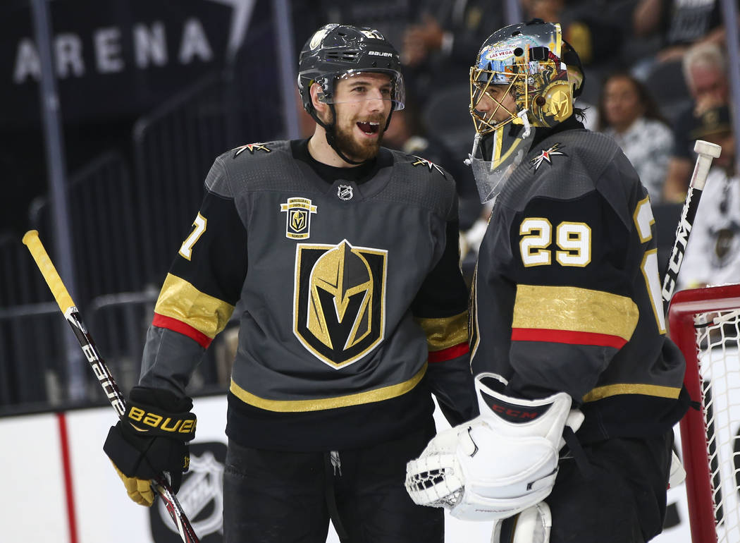 Golden Knights defenseman Shea Theodore (27) talks with goaltender Marc-Andre Fleury (29) during the second period of Game 3 of the NHL Western Conference finals hockey playoff series against the ...