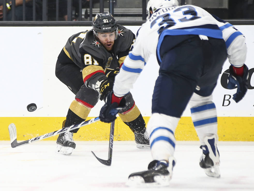 Golden Knights center Jonathan Marchessault (81) sends the puck past Winnipeg Jets defenseman Dustin Byfuglien (33) during the third period of Game 3 of the NHL Western Conference finals hockey pl ...