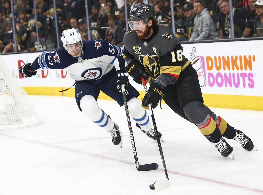 Golden Knights left wing James Neal (18) moves the puck past Winnipeg Jets defenseman Tyler Myers (57) during the third period of Game 3 of the NHL Western Conference finals hockey playoff series ...