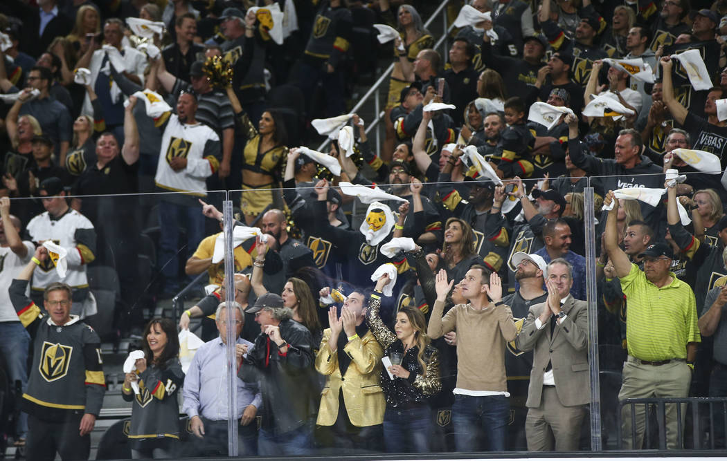Golden Knights fans cheer during the third period of Game 3 of the NHL Western Conference finals hockey playoff series against the Winnipeg Jets at T-Mobile Arena in Las Vegas on Wednesday, May 16 ...