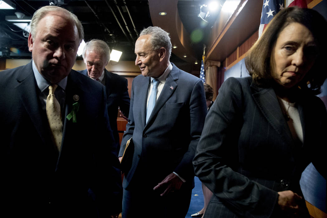 From left, Rep. Mike Doyle, D-Pa., Sen. Ed Markey, D-Mass., Senate Minority Leader Sen. Chuck Schumer of N.Y., and Sen. Maria Cantwell, D-Wash., leave a news conference on Capitol Hill in Washingt ...