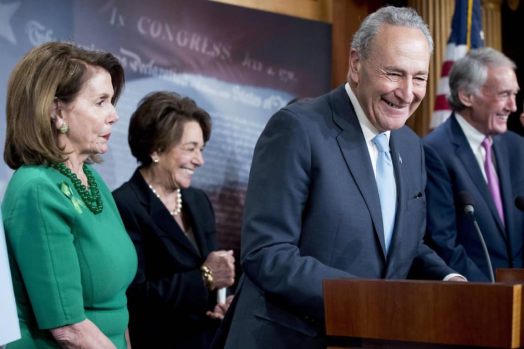 Senate Minority Leader Sen. Chuck Schumer of N.Y., accompanied by Sen. Ed Markey, D-Mass., right, Rep. Anna Eshoo, D-Calif., second from left, and House Minority Leader Nancy Pelosi of Calif., lef ...