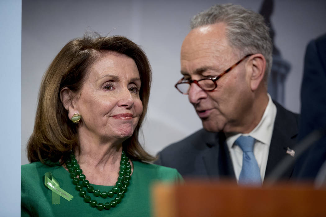 Senate Minority Leader Sen. Chuck Schumer of N.Y., right, and House Minority Leader Nancy Pelosi of Calif., left, speak together during a news conference on Capitol Hill in Washington, Wednesday, ...