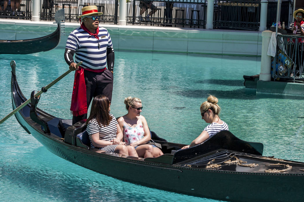 "Golden Knights national anthem singer Carnell Johnson, also known as ""Golden Pipes,"" takes Scottish visitors, from left, Michelle Brooks, Natasha Anderson and Alexandra Orr for a gondola ..."