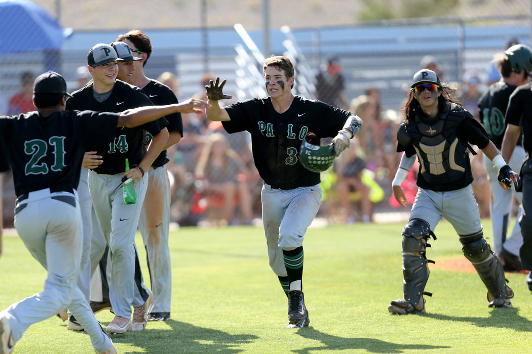 Palo Verde E.J. Arnold (34) celebrates with his teammates after scoring against Centennial in the third inning of their Sunset Region baseball game at Centennial High School Thursday, May 10, 2018 ...
