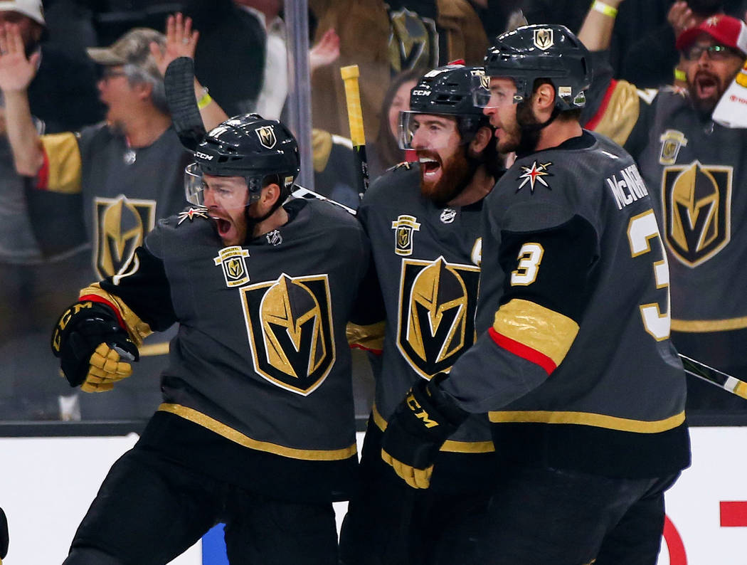 Golden Knights center Jonathan Marchessault, left, celebrates his goal with teammates, James Neal (18), center, and Brayden McNabb (3) during the first period of Game 3 of the NHL Western Conferen ...