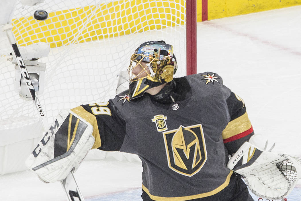 Golden Knights goaltender Marc-Andre Fleury (29) makes a save in the second period during game three of Las Vegas' NHL Western Conference Finals matchup with Winnipeg on Wednesday, May 16, 2018, a ...