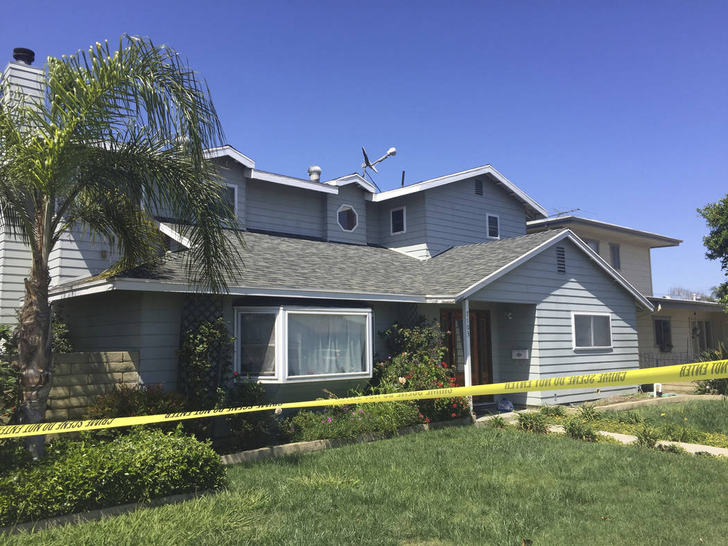 The home of a homicide victim, Ildiko Krajnyak, is seen after it was searched by police overnight in Trabuco Canyon, Calif., Wednesday, May 16, 2018. Sheriff's officials have officially identified ...