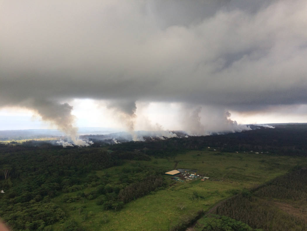 Sulfur dioxide plumes rising from fissures along the rift and accumulating in the cloud deck, viewed from the Hawaiian Volcano Observatory overflight in the morning at 8:25 a.m., HST near Pahoa, H ...