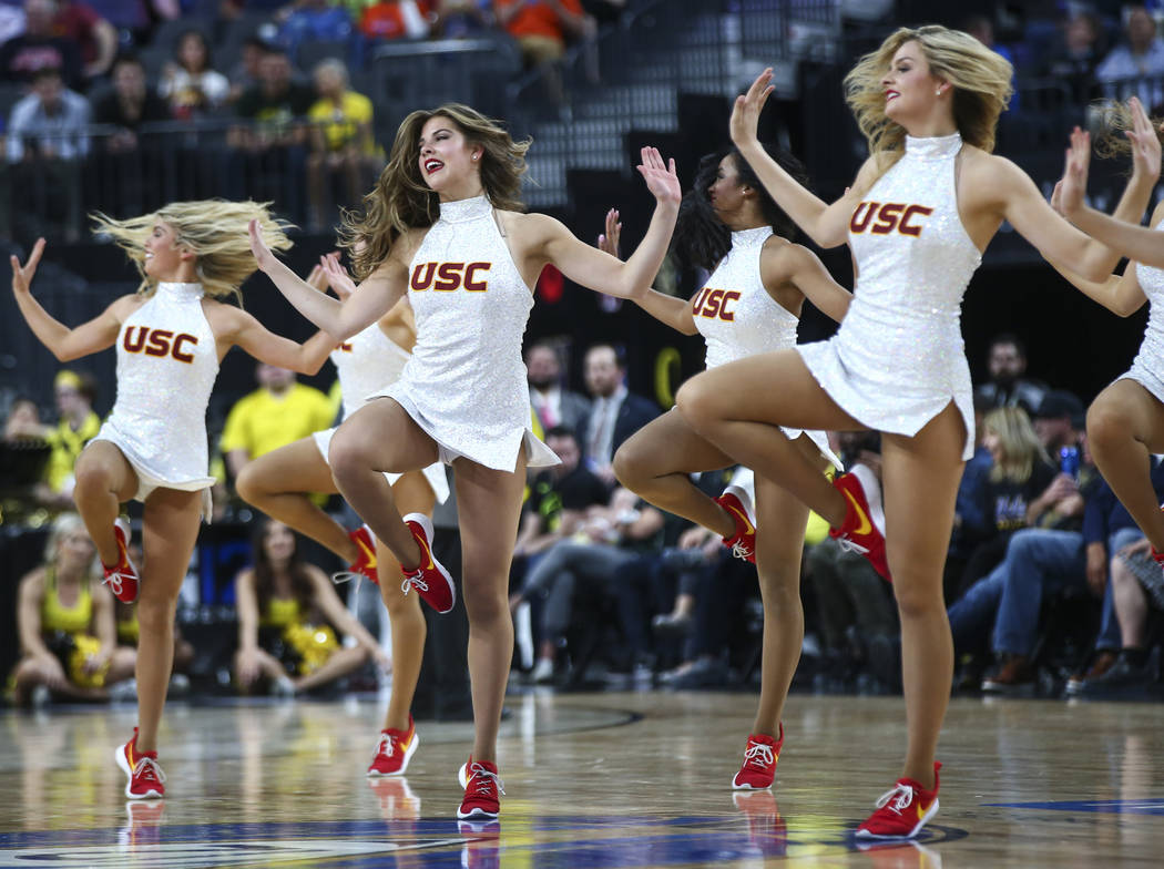 USC Trojans cheerleaders perform during the first half of a semifinal basketball game against the Oregon Ducks in the Pac-12 basketball tournament at T-Mobile Arena in Las Vegas on Friday, March 9 ...
