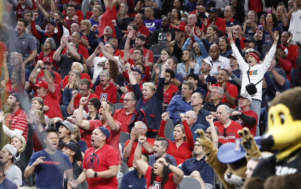 Arizona Wildcats fans cheer for their team during an NCAA college basketball game against Colorado Buffaloes in the quarter final of the Pac-12 tournament on Thursday, March 8, 2018, in Las Vegas. ...