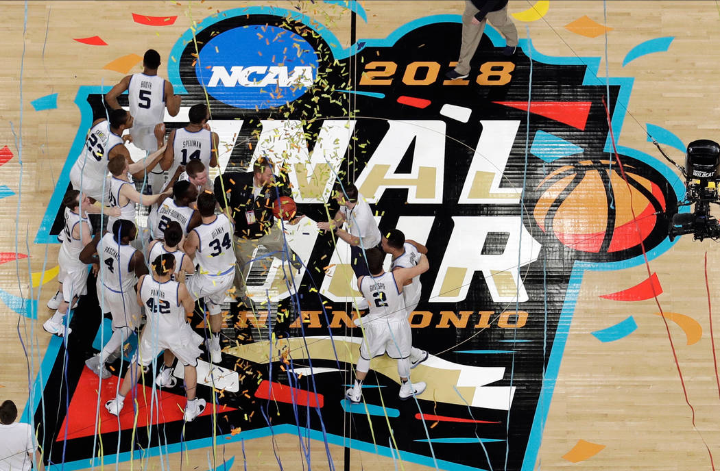 Villanova players celebrate after the championship game of the Final Four NCAA college basketball tournament against Michigan, Monday, April 2, 2018, in San Antonio. Villanova won 79-62. (Morry Ga ...