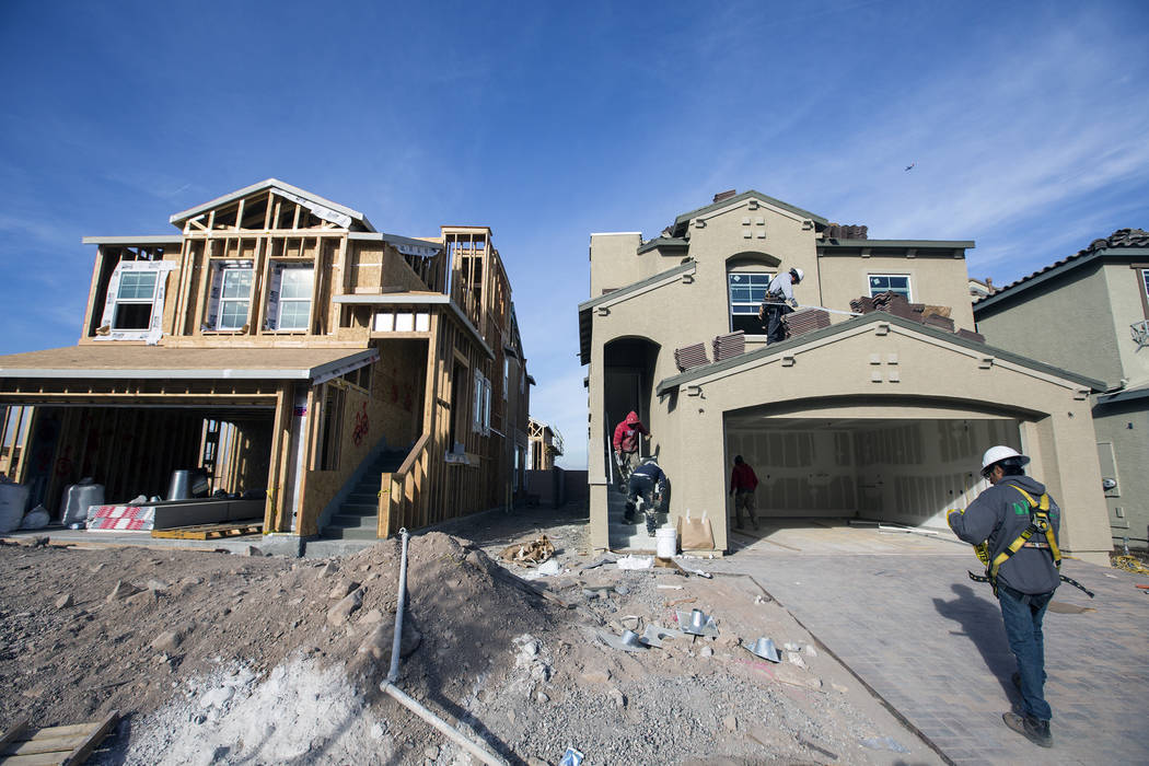 Men work on a single family-homes at Cadence, a 2,300-acre master planned community, in Henderson in 2016. (Las Vegas Review-Journal 2016 photo)