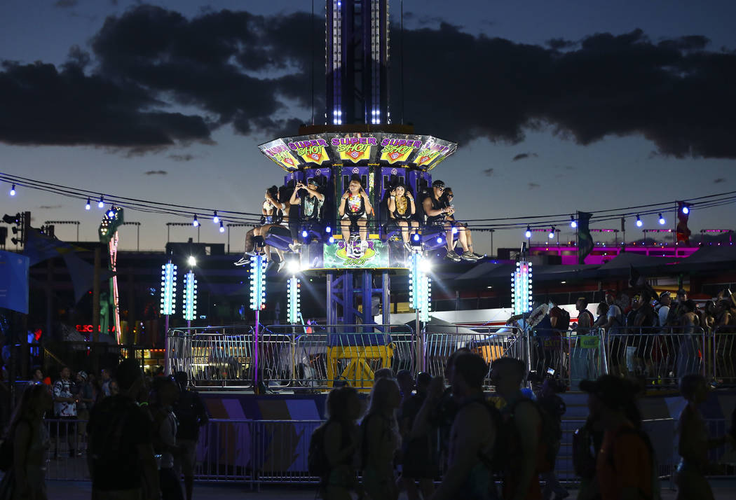 Attendees enjoy a carnival ride during the first day of the Electric Daisy Carnival at the Las Vegas Motor Speedway in Las Vegas on Friday, May 18, 2018. Chase Stevens Las Vegas Review-Journal @cs ...