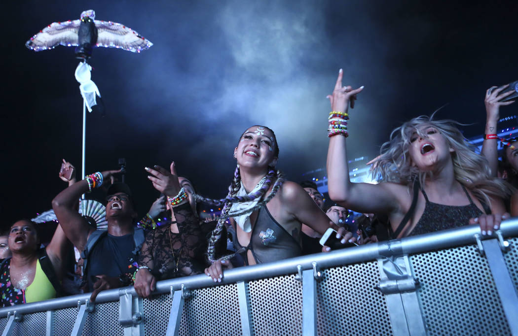 Attendees dance as Mike Will Made It performs at the Cosmic Meadow stage during the first day of the Electric Daisy Carnival at the Las Vegas Motor Speedway in Las Vegas on Friday, May 18, 2018. C ...