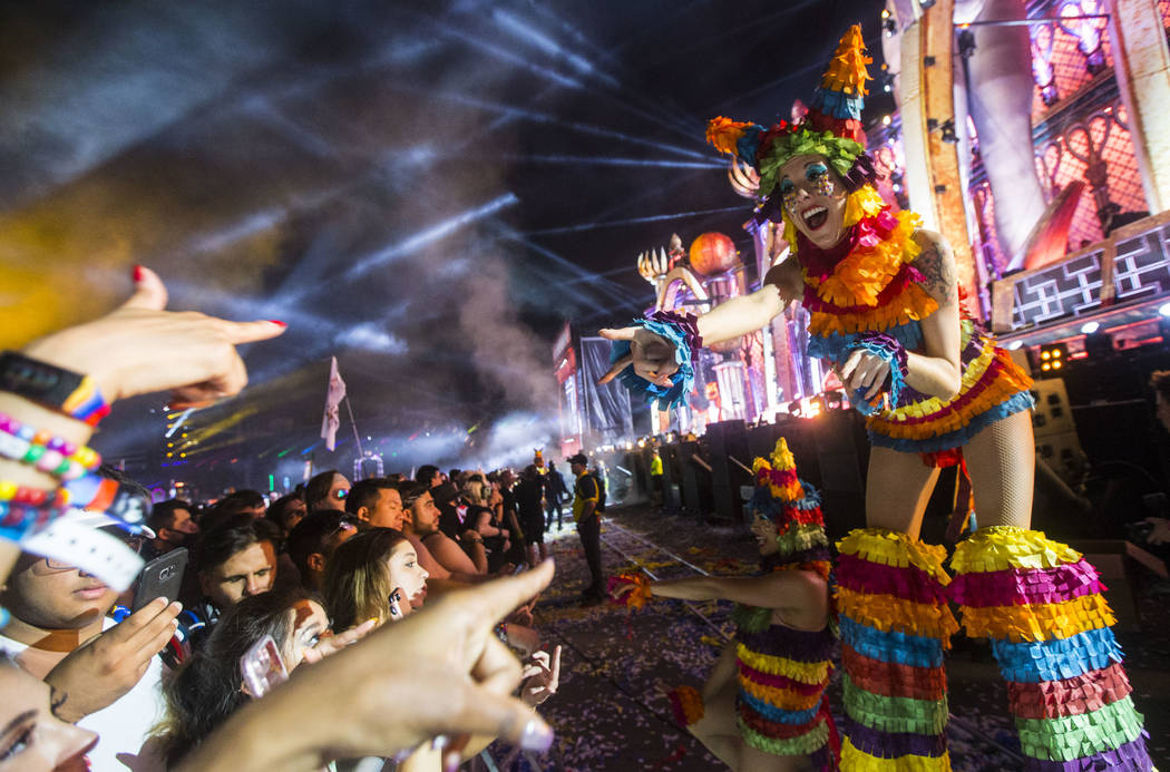 A costumed performer on stilts entertains fans at Kinetic Field during the first day of the Electric Daisy Carnival at the Las Vegas Motor Speedway in Las Vegas during the early hours of Saturday, ...