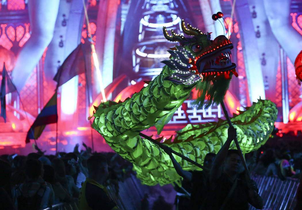 A Chinese dragon roams the crowd at Kinetic Field during the first day of the Electric Daisy Carnival at the Las Vegas Motor Speedway in Las Vegas during the early hours of Saturday, May 19, 2018. ...