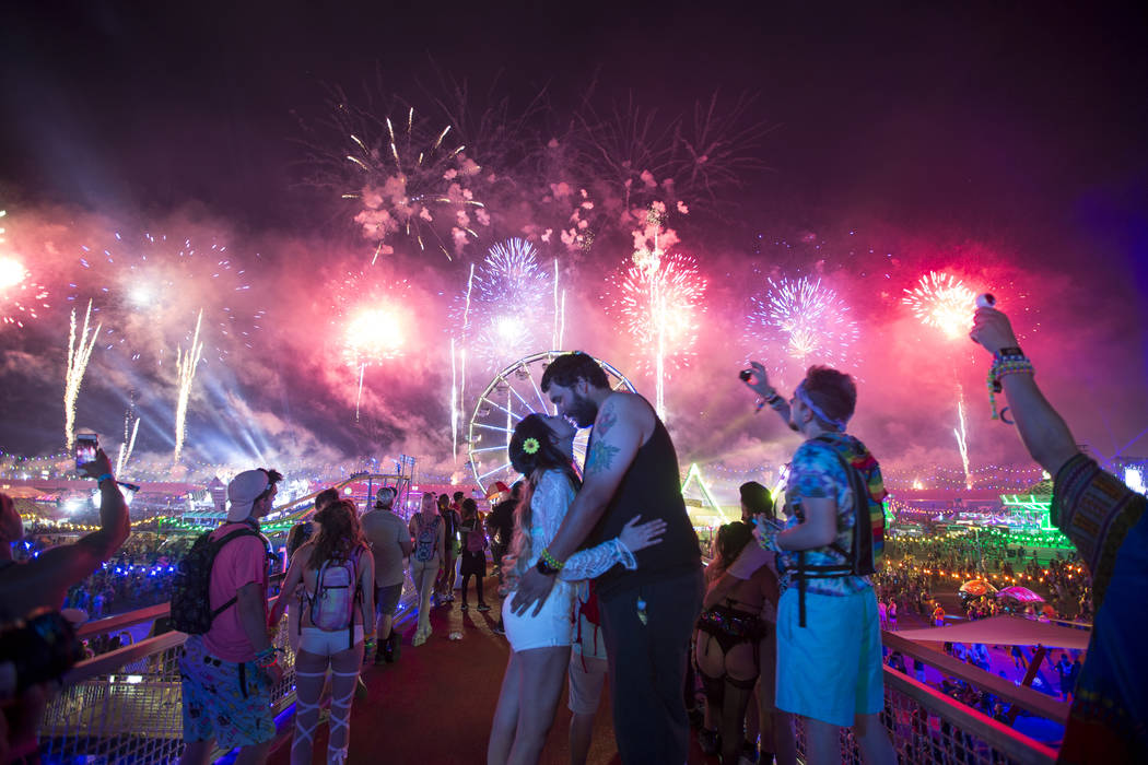 Festivalgoers Yolanda Retana, left, and Albert Robles of Los Angeles, Calif., share a kiss during a firework show on day one of the Electric Daisy Carnival at the Las Vegas Motor Speedway on Satur ...