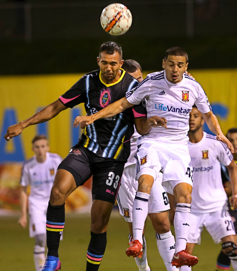 Las Vegas Lights FC defender Miguel Garduno (33) and Real Monarchs midfielder Justin Portillo (43) vie for the ball during the second half of a United Soccer League game at Cashman Field in Las Ve ...