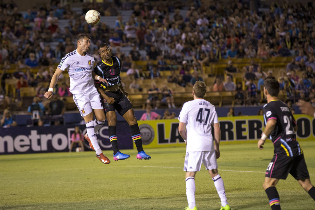 Real Monarchs forward Ricardo Espin-Lopez, left, and Las Vegas Lights FC defender Miguel Garduno, second left, vie for the ball during the first half of a United Soccer League game at Cashman Fiel ...