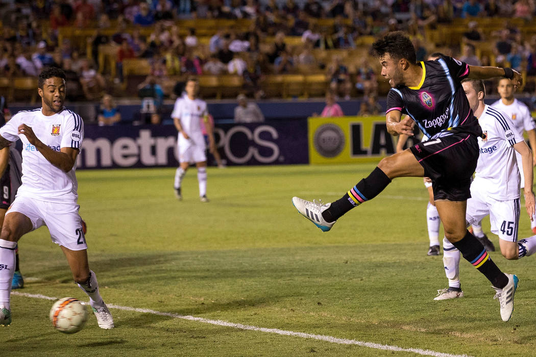 Las Vegas Lights FC midfielder/forward Carlos Alvarez takes a shot on goal against the Real Monarchs during the first half of a United Soccer League game at Cashman Field in Las Vegas on Saturday, ...