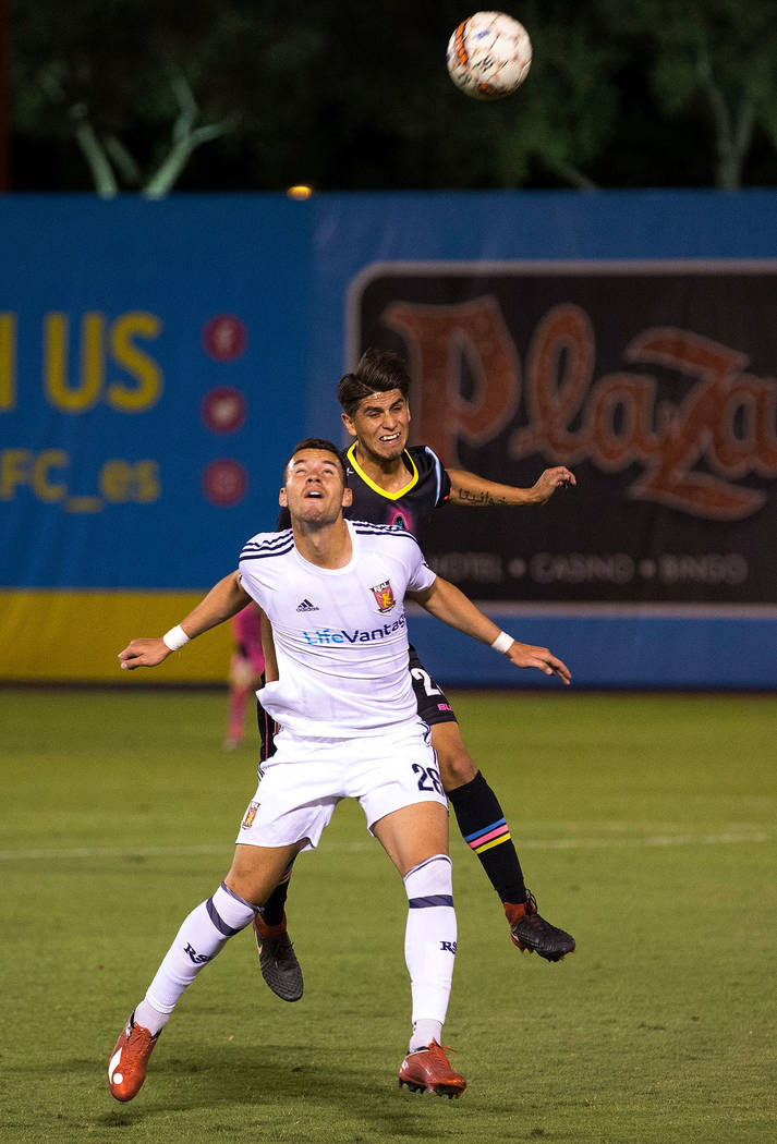 Real Monarchs forward Ricardo Espin-Lopez, foreground, and Las Vegas Lights FC defender/midfielder Christian Torres jump for the header during the first half of a United Soccer League game at Cash ...