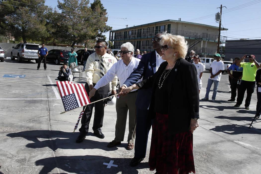 Juan Salinas, left, director of Social Service at the Salvation Army, Ward 3 Councilman Bob Coffin, Pastor Michael Hatch, second right, and Las Vegas Mayor Carolyn Goodman kicked off the demolitio ...