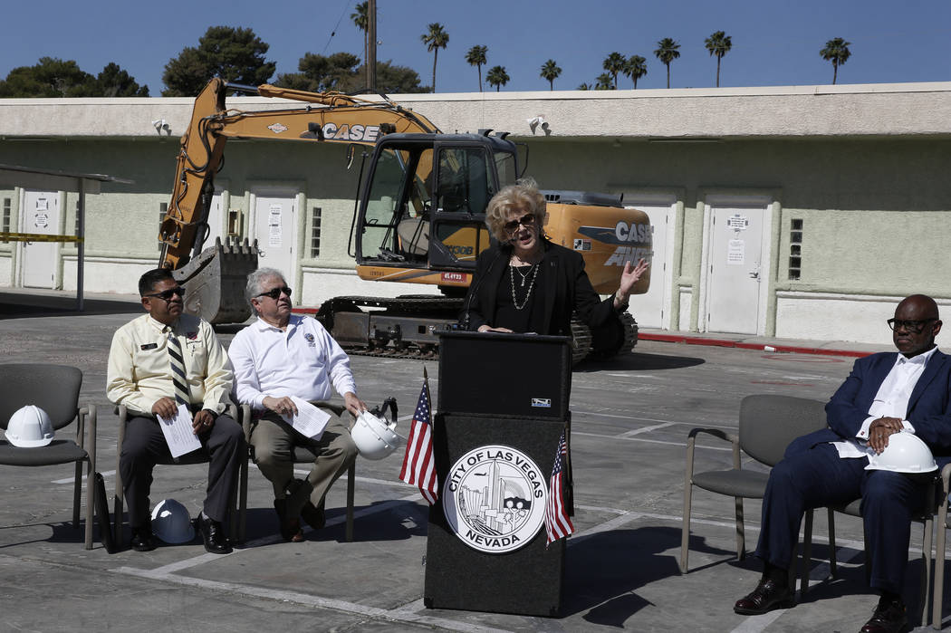 Juan Salinas, left, director of Social Service at the Salvation Army, Ward 3 Councilman Bob Coffin, and Pastor Michael Hatch, right, listen as Las Vegas Mayor Carolyn Goodman speaks on Thursday, M ...