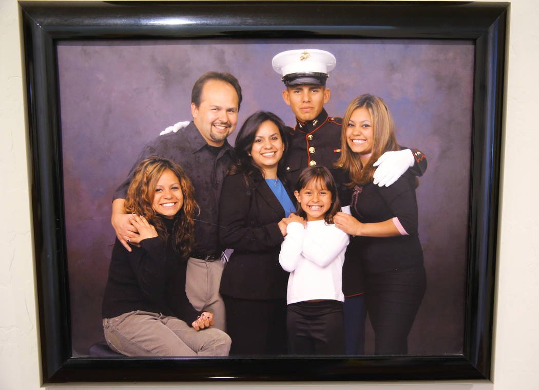 Richard Perez Sr., left, with his son in a family photo shown at his Henderson home on May 17, 2018. Also pictured are, from left, daughter Rheanne, wife Rosemarie, daughter Risa and daughter Rich ...