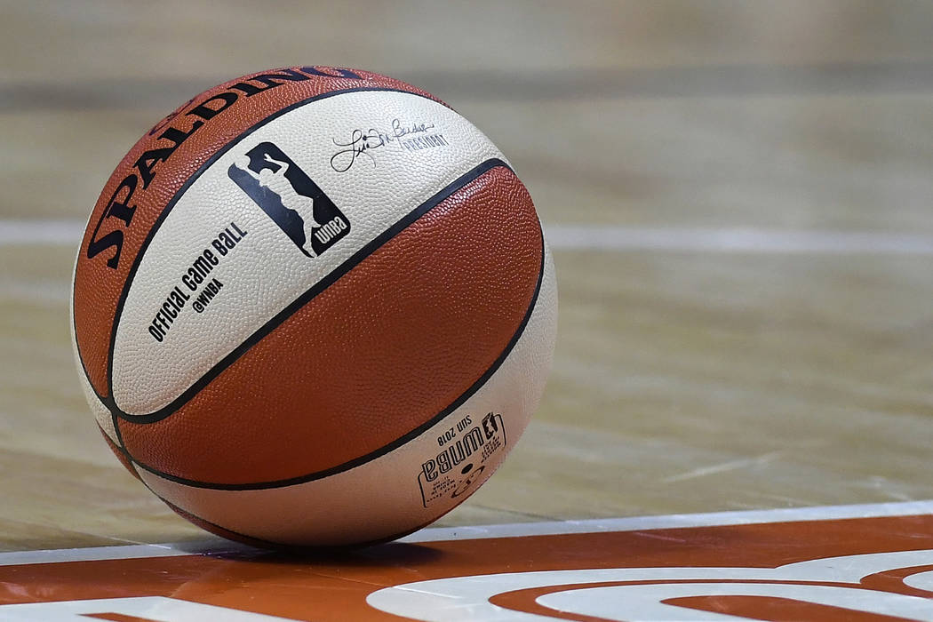 A WNBA basketball rests on the court during a preseason game, Wednesday, May 8, 2018, in Uncasville, Conn. (AP Photo/Jessica Hill)