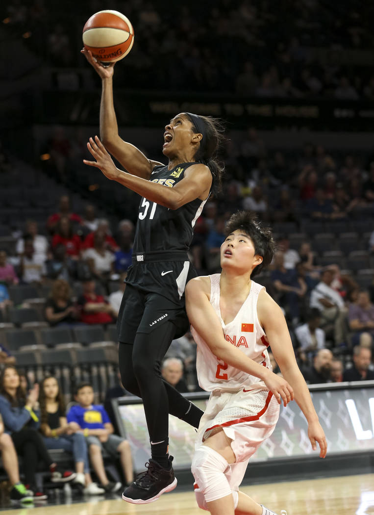 Las Vegas Aces guard Sydney Colson (51) goes up for a shot against China's Jiaqi Wang (2) during a preseason basketball game at Mandalay Bay Events Center in Las Vegas on Sunday, May 6, 2018. Rich ...