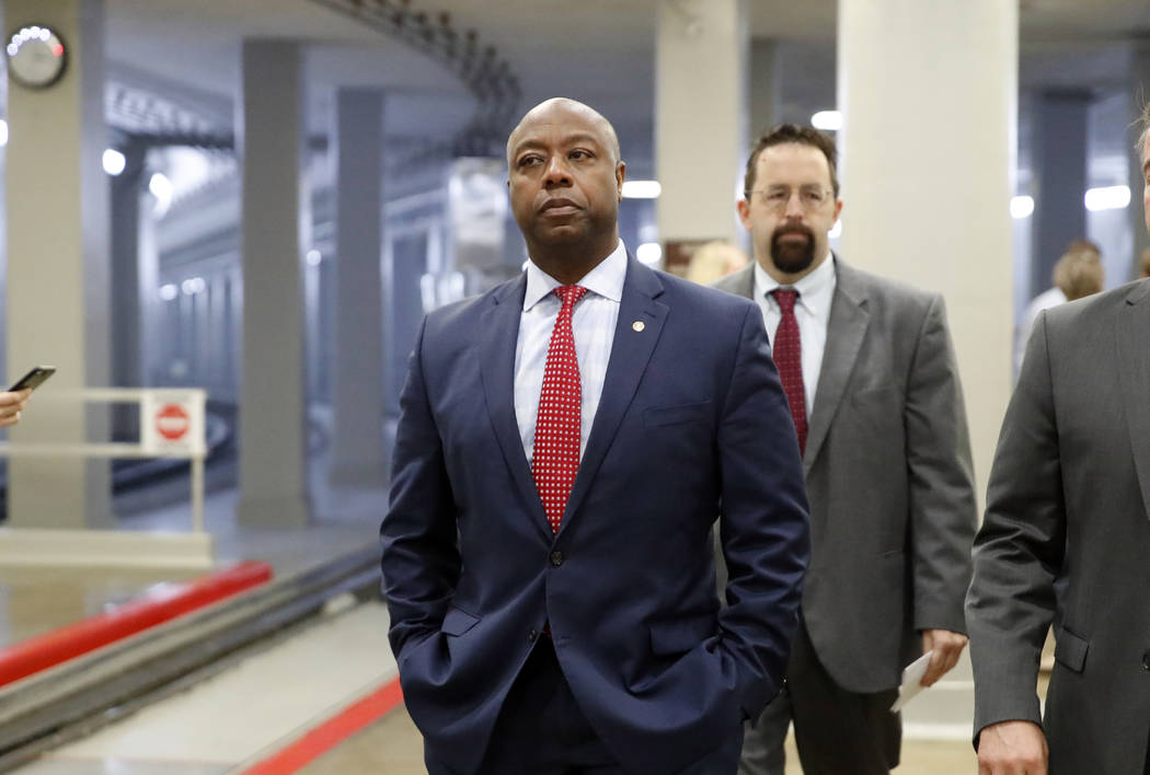 Sen. Tim Scott, R-S.C., arrives for a vote on Gina Haspel to be CIA director, on Capitol Hill, Thursday, May 17, 2018 in Washington. (AP Photo/Alex Brandon)