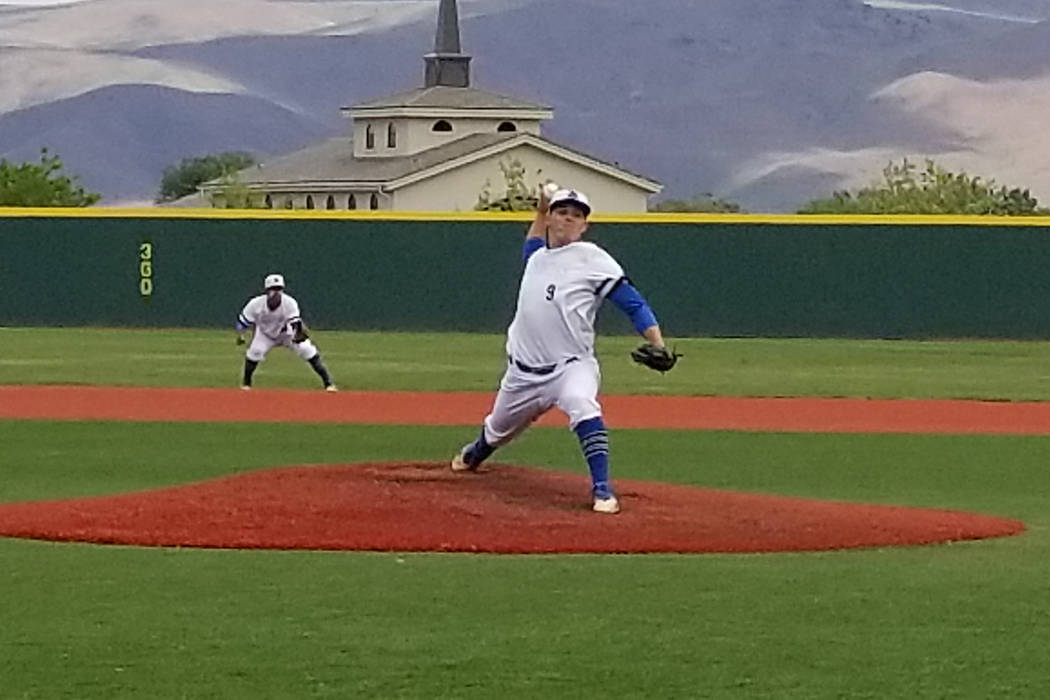 Basic's C.J. Dornak fires a pitch against Reno in the Class 4A state baseball tournament on Thursday, May 17, 2018 at Bishop Manogue in Reno. Dornak pitched a complete game and struck out nine, bu ...