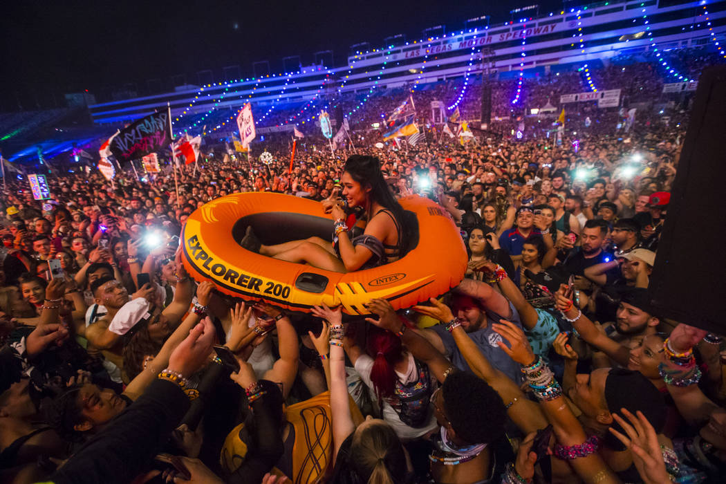 An attendee crowdsurfs on a small raft while waiting for Post Malone at the Cosmic Meadow stage during the third day of the Electric Daisy Carnival at the Las Vegas Motor Speedway in Las Vegas on ...