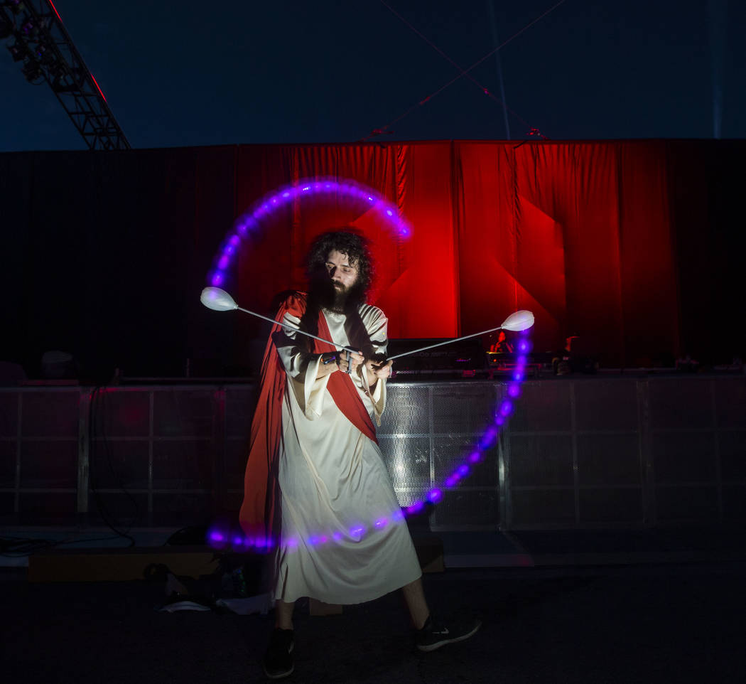 George Menocic of Las Vegas performs a light show while dressed as Jesus during the first day of the Electric Daisy Carnival at the Las Vegas Motor Speedway in Las Vegas on Friday, May 18, 2018. C ...