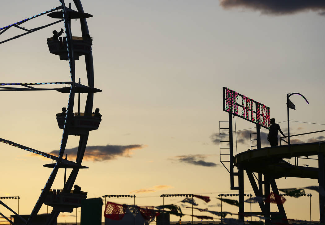 Attendees are silhouetted as the sun sets during the first day of the Electric Daisy Carnival at the Las Vegas Motor Speedway in Las Vegas on Friday, May 18, 2018. Chase Stevens Las Vegas Review-J ...