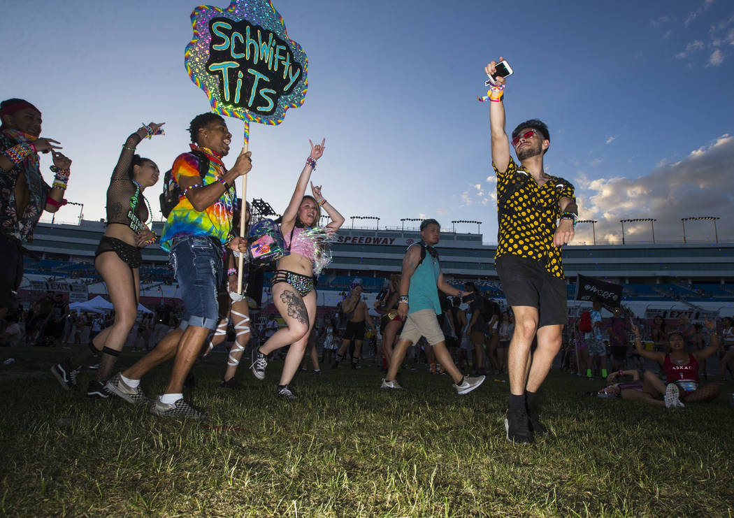 Jesus Hernandez of Bakersfield, Calif., right, dances at the Cosmic Meadow stage during the first day of the Electric Daisy Carnival at the Las Vegas Motor Speedway in Las Vegas on Friday, May 18, ...