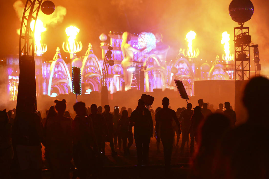 Attendees are sillhouetted as pyrotechnics go off at the Kinetic Field stage during the first day of the Electric Daisy Carnival at the Las Vegas Motor Speedway in Las Vegas on Friday, May 18, 201 ...
