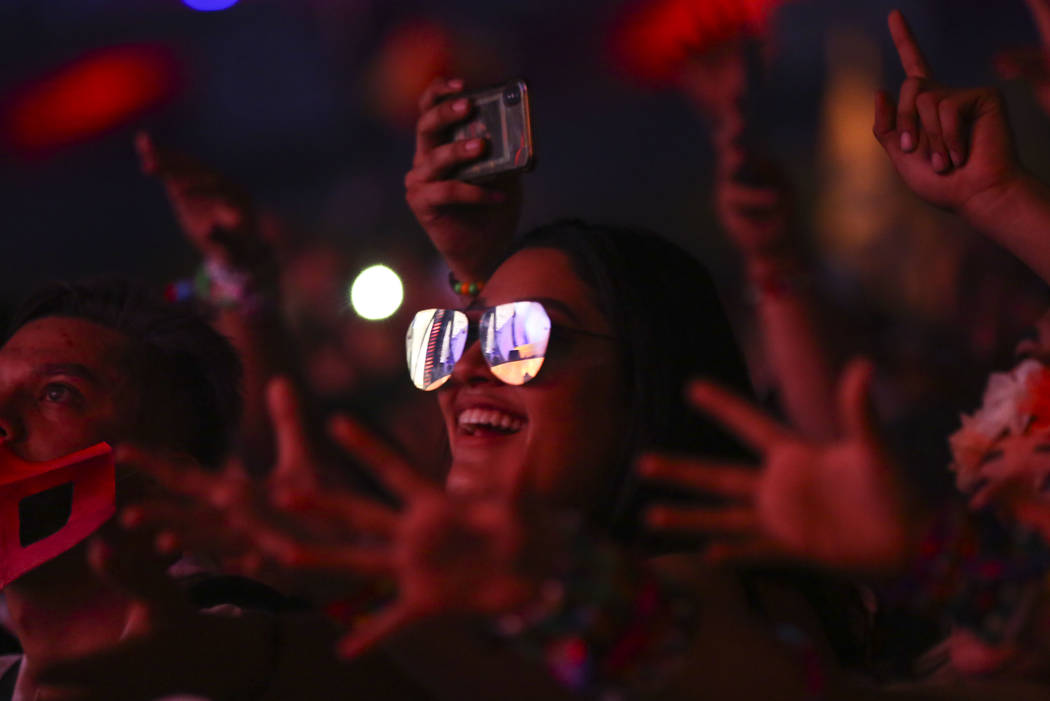 Attendees react as Mike Will Made It performs at the Cosmic Meadow stage during the first day of the Electric Daisy Carnival at the Las Vegas Motor Speedway in Las Vegas on Friday, May 18, 2018. C ...
