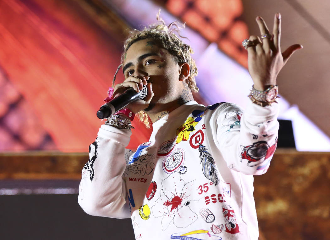 Rapper Lil' Pump joins Diplo for a pair of songs at Kinetic Field during the first day of the Electric Daisy Carnival at the Las Vegas Motor Speedway in Las Vegas during the early hours of Saturda ...