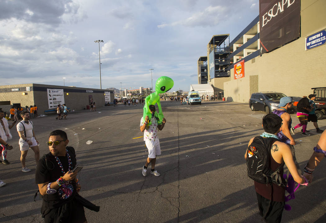 Victor Santisteban of Las Vegas, center, arrives for the third day of the Electric Daisy Carnival at the Las Vegas Motor Speedway in Las Vegas on Sunday, May 20, 2018. Chase Stevens Las Vegas Revi ...