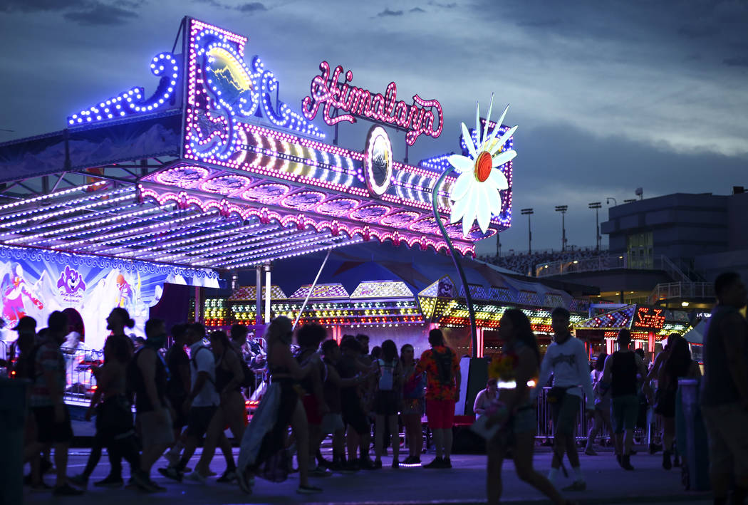 Attendees walk past a carnival ride during the third day of the Electric Daisy Carnival at the Las Vegas Motor Speedway in Las Vegas on Sunday, May 20, 2018. Chase Stevens Las Vegas Review-Journal ...