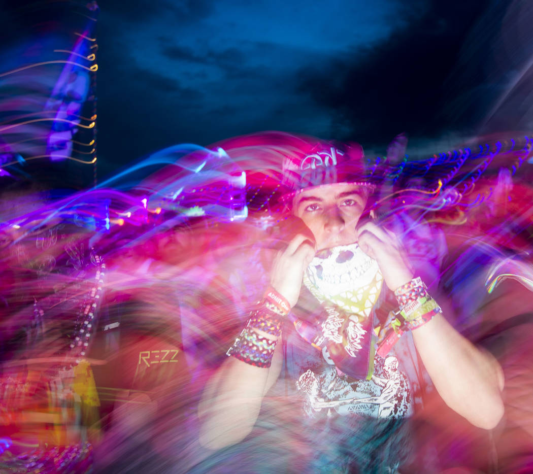An attendee watches as Dateless performs at the Stereobloom stage during the third day of the Electric Daisy Carnival at the Las Vegas Motor Speedway in Las Vegas on Sunday, May 20, 2018. Chase St ...
