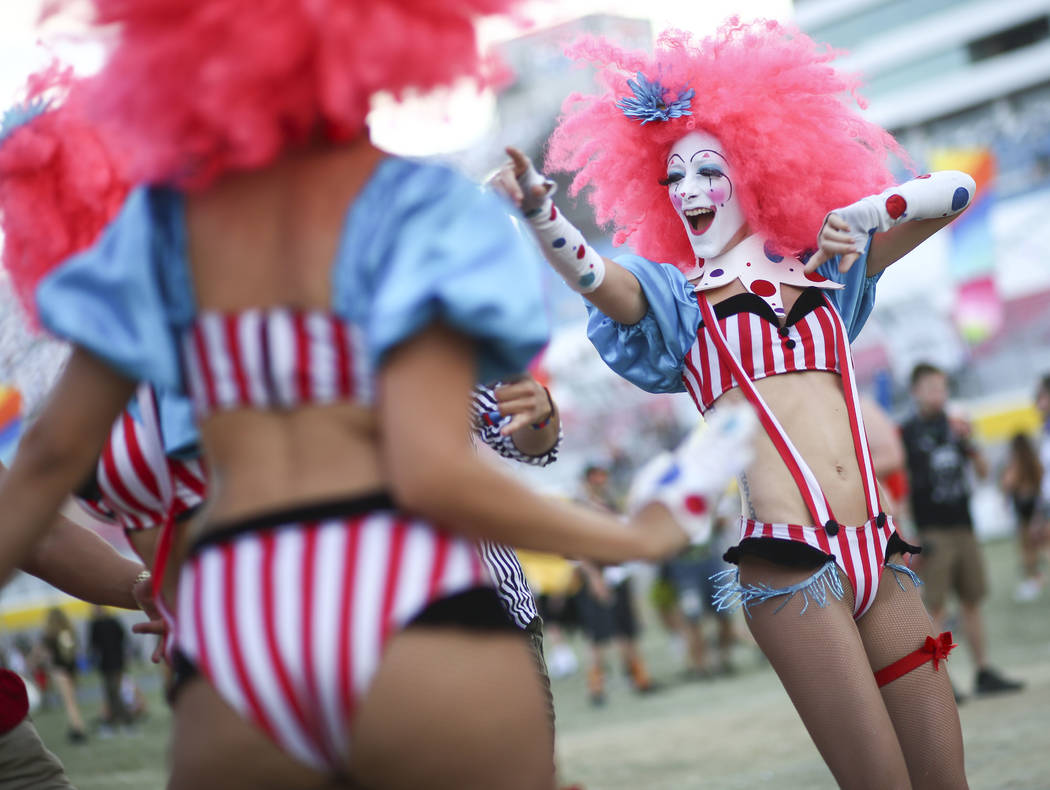 Costumed performers entertain fans by the Cosmic Meadow stage during the third day of the Electric Daisy Carnival at the Las Vegas Motor Speedway in Las Vegas on Sunday, May 20, 2018. Chase Steven ...