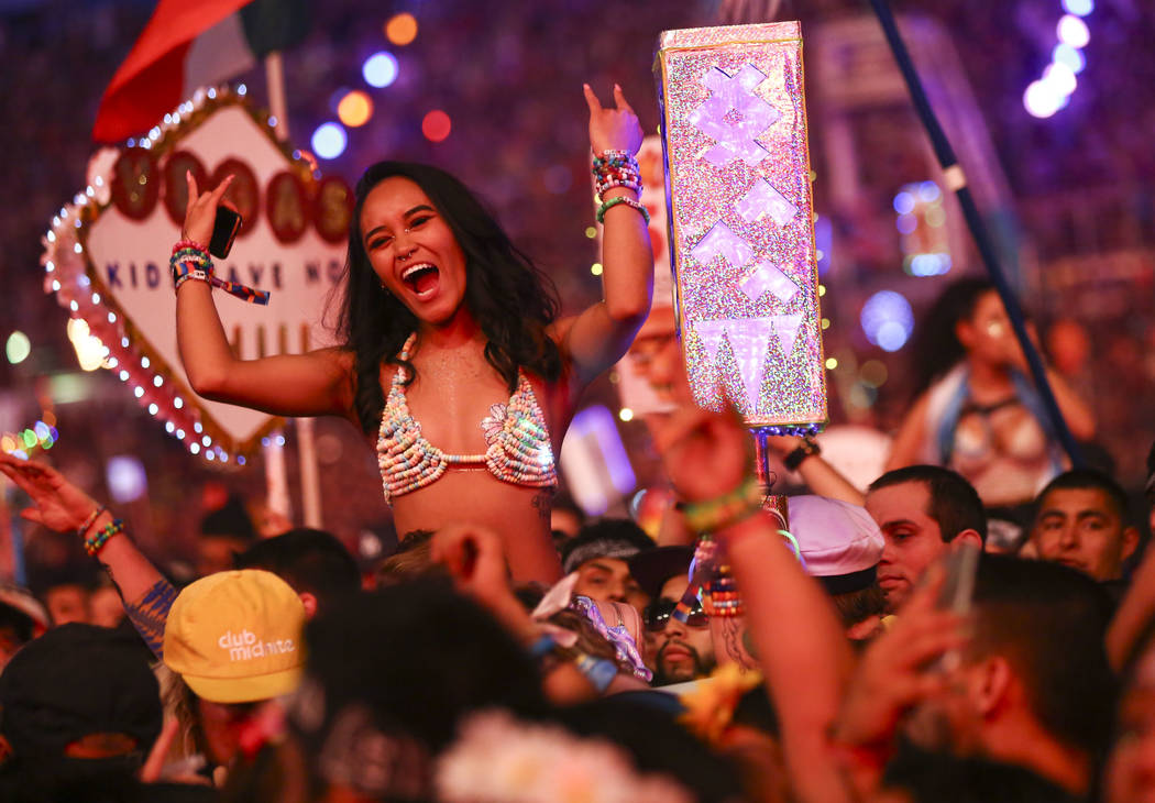 Attendees cheer while waiting for Post Malone at the Cosmic Meadow stage during the third day of the Electric Daisy Carnival at the Las Vegas Motor Speedway in Las Vegas on Sunday, May 20, 2018. C ...