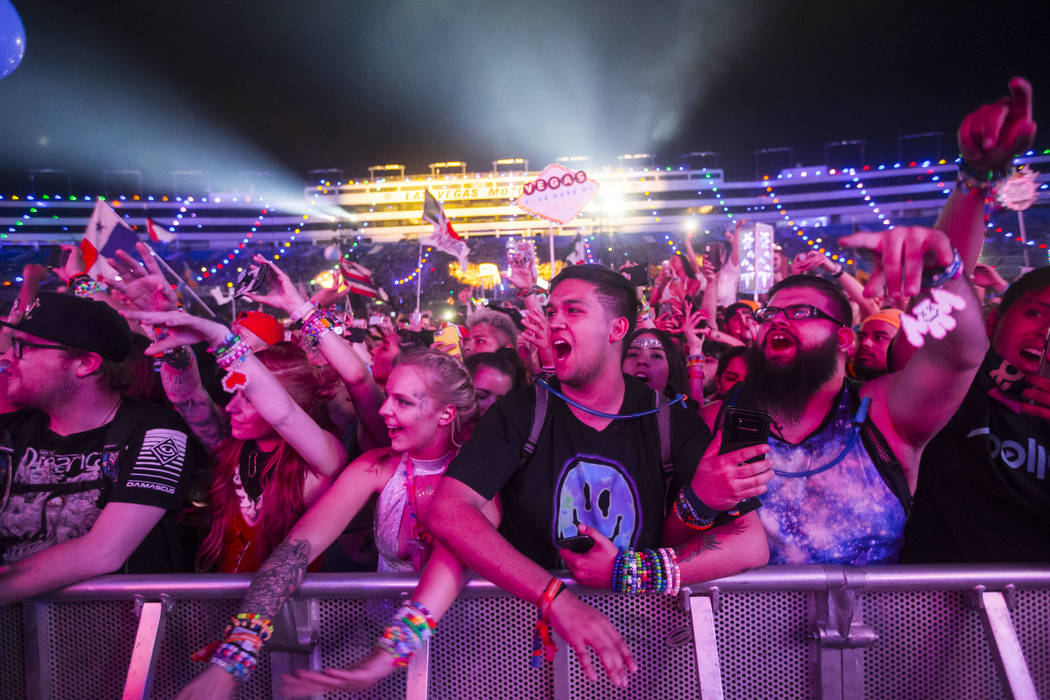 Attendees sing along as Post Malone performs at the Cosmic Meaddow stage during the third day of the Electric Daisy Carnival at the Las Vegas Motor Speedway in Las Vegas on Sunday, May 20, 2018. C ...