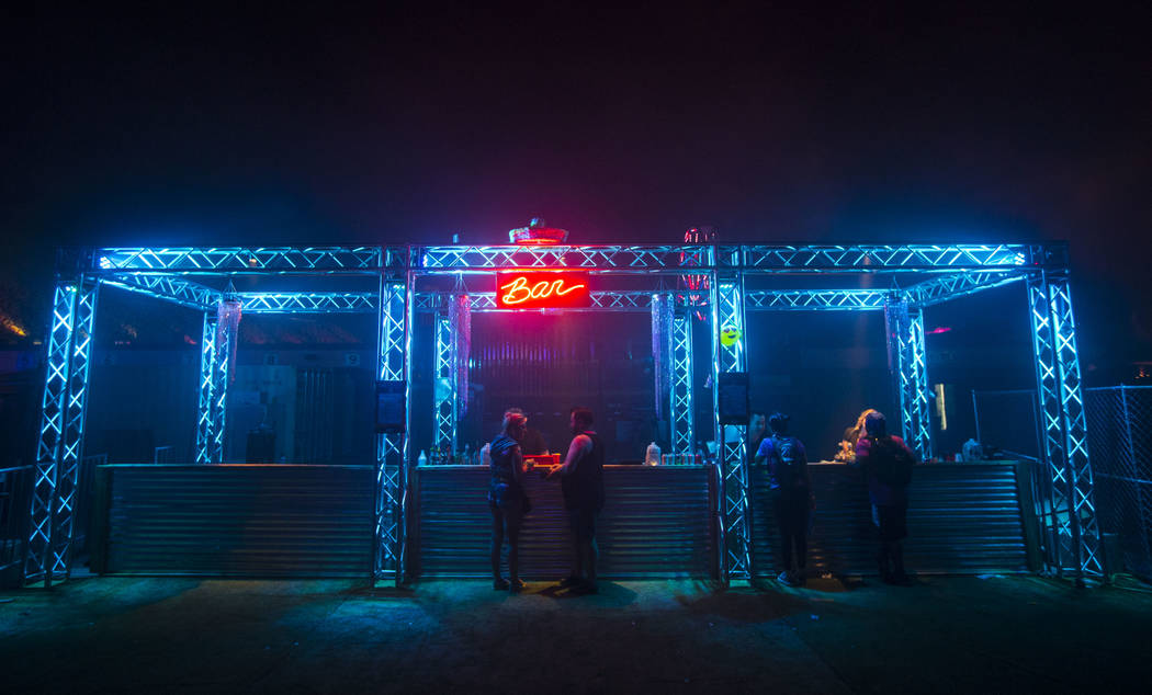 Attendees stop for a drink at a bar area during the third day of the Electric Daisy Carnival at the Las Vegas Motor Speedway in Las Vegas during the early hours of Monday, May 21, 2018. Chase Stev ...