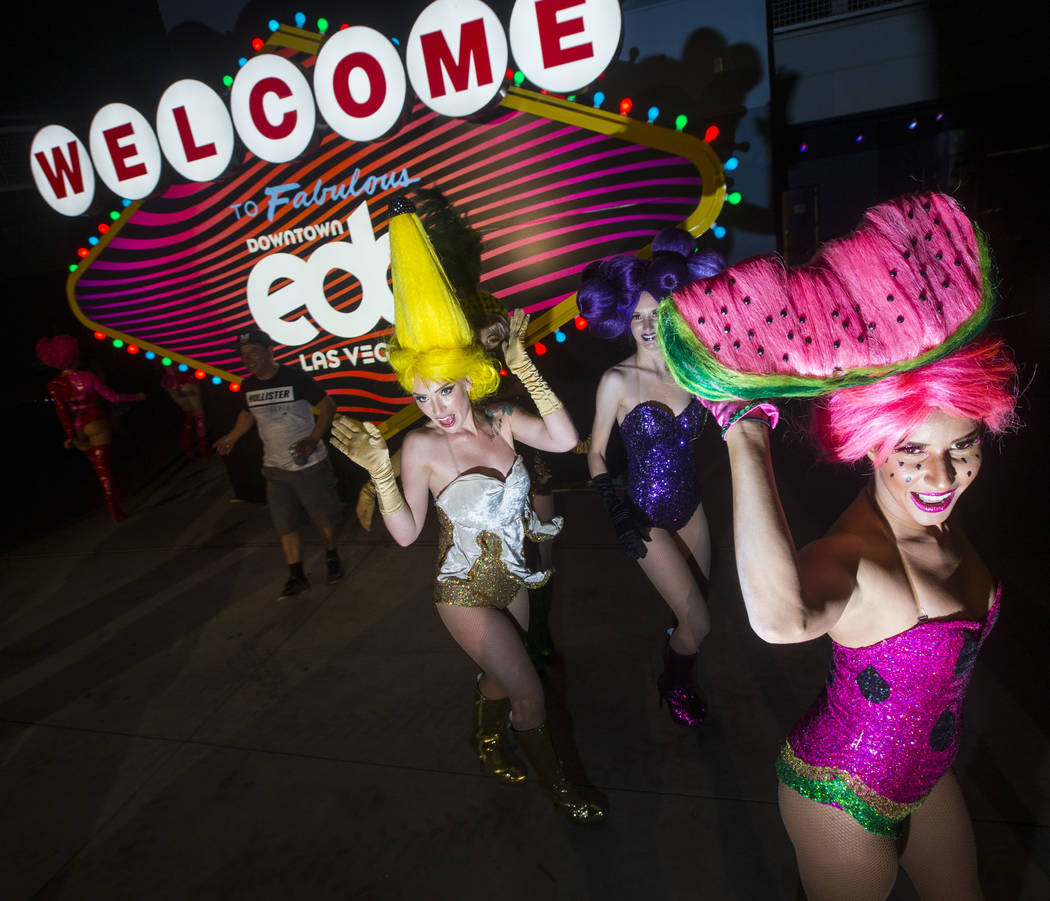 The Juicy Fruits, a group of costumed performers, make their way through the carnival square area during the second day of the Electric Daisy Carnival at the Las Vegas Motor Speedway in Las Vegas ...