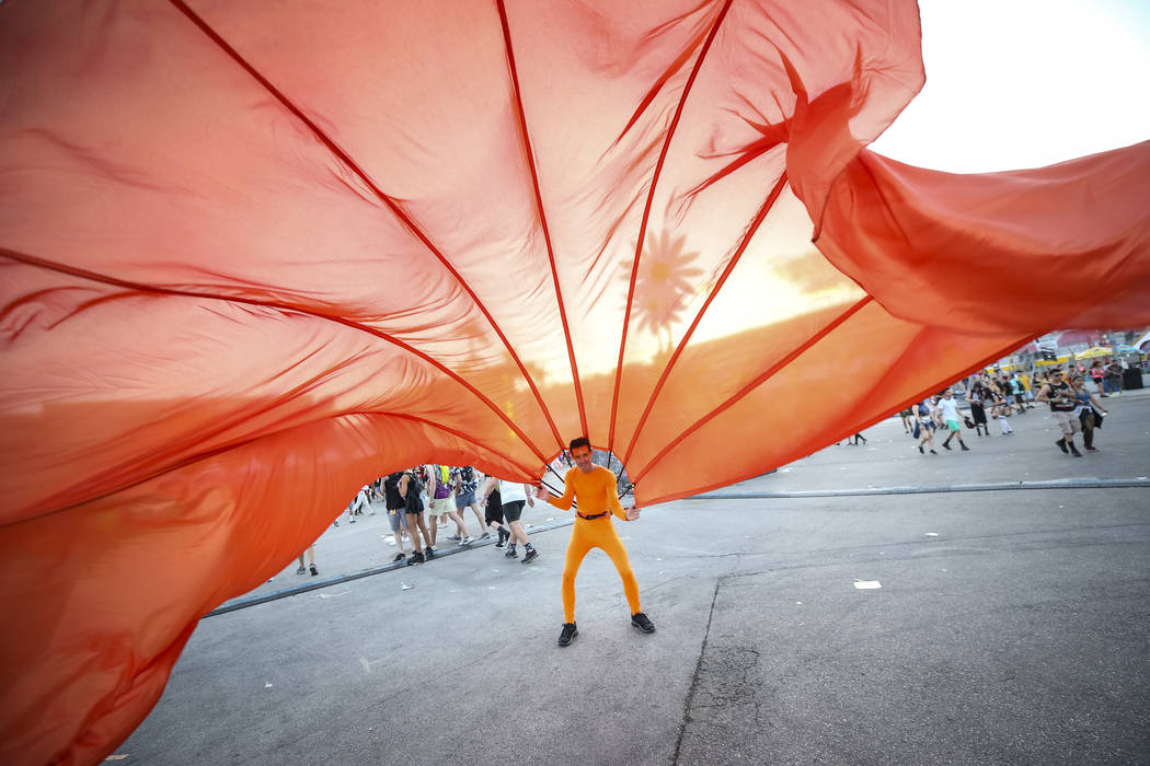 A member of the Rainbow Fans entertains the crowd on day one of the Electric Daisy Carnival at the Las Vegas Motor Speedway on Friday, May 18, 2018. Richard Brian Las Vegas Review-Journal @vegasph ...