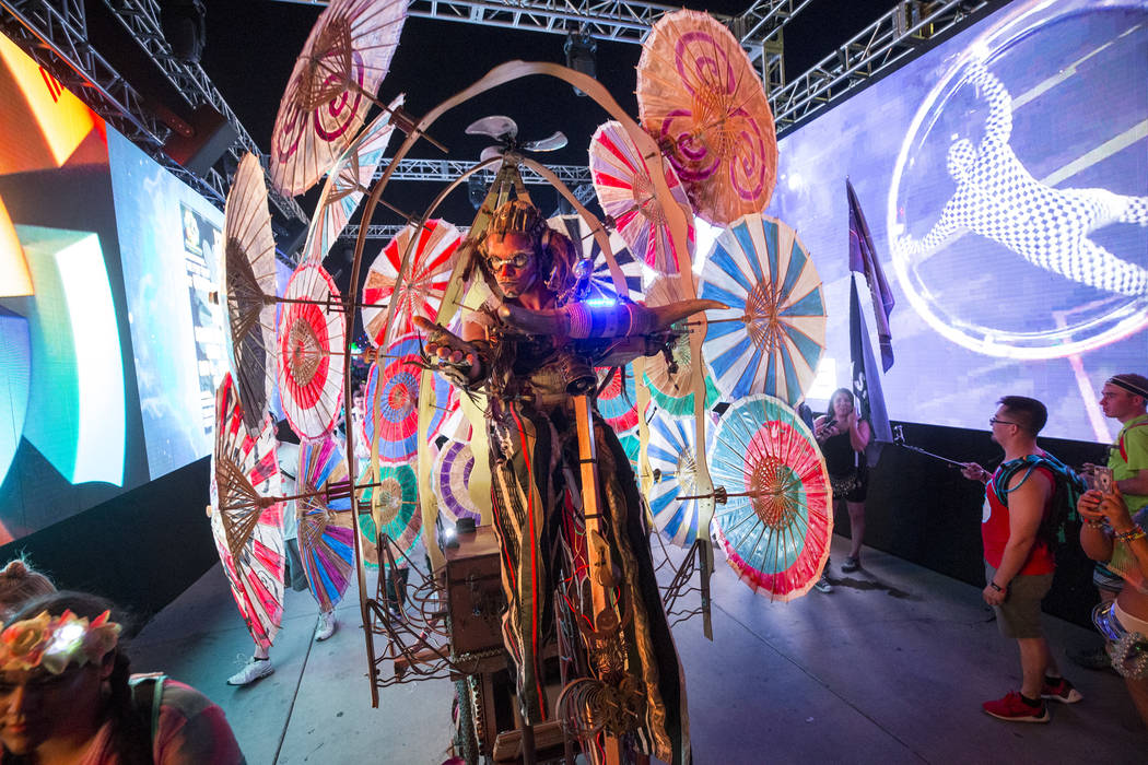 A performer on a bicycle wanders through the crowd on day one of the Electric Daisy Carnival at the Las Vegas Motor Speedway on Friday, May 18, 2018. Richard Brian Las Vegas Review-Journal @vegasp ...